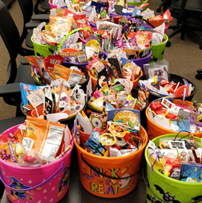 HMI Student Group Delivers Buckets of Halloween Candy to Children at Shelter, Wins Impact Award